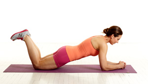 Modified Regular Plank. Maintain flat back AT ALL TIMES. Do not allow your back to round and create an excessive curve in your lumbar (lower back) spine.  (image from fitbie.msn.com)